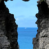 View of Shelley Bay through a hole in the wall.