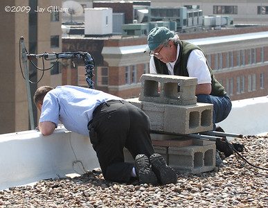 Pat Schlarbaum and Dallas Roper adjusting the webcam on top of the roof.  The address of the falcon webcam is:  http://www.iowadnr.gov/wildlife/diversity/falconcam.html