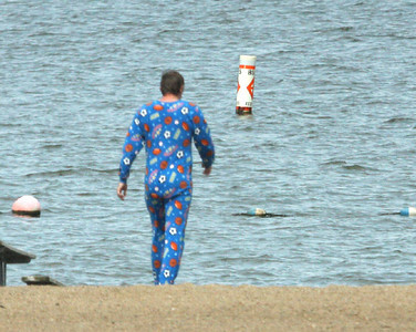 This was a strange sight!  I saw this guy walking across the Oak Grove beach one morning in onesie pajamas!  08-16-09