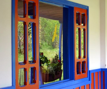 Several areas in Colombia featured brightly colored windows, doors, and trim.  Attractive touch and attention to details.