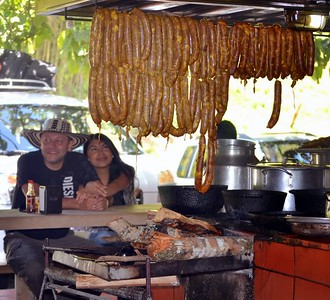 Typical roadside restaurant offering Chorizzo sausage - grilled over wood fire. These restaurants were typically very busy and offered efficient service.