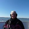 Jeane on the deck of our luxury yacht - trying to stay warm.