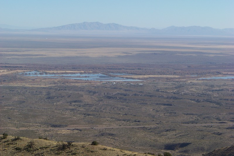 """A slightly zoomed look at the managed wetland...the """"reddish"""" tint just above the water are stands of cottonwoods that are able to grow near the Rio Grande and the irrigation channels for the refuge.  The Rio Grande Rift is the 2nd largest rift valley in the world."""