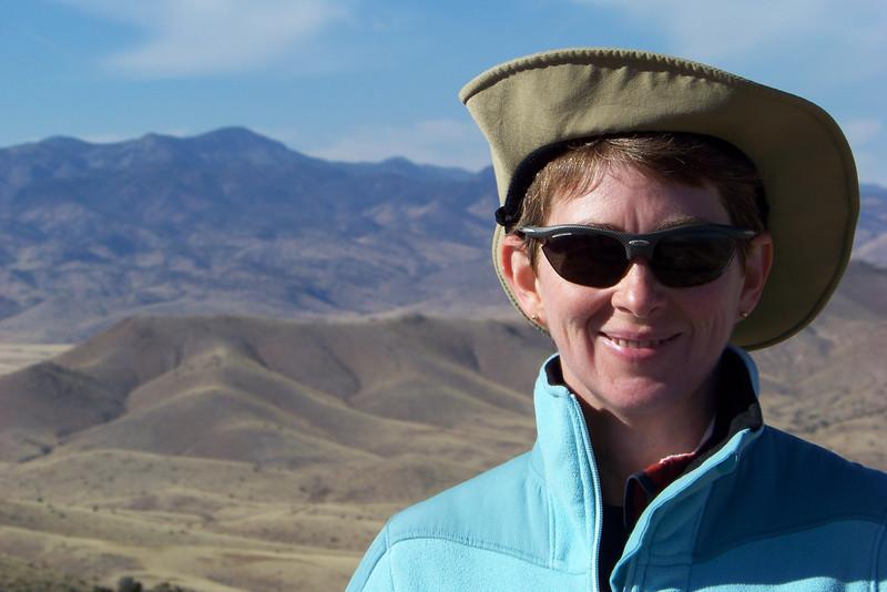 Windblown and slightly sun-blasted Patti on Chupadera Peak