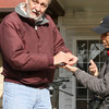 """Lanny with the help of Jean releasing a banded  <br> Rufous Hummingbird  <br> Franklin County <br><br><span class=""""noShowSmart""""> <a href=""""/MyKeywords/Bird-Videos/n-gF9bt/i-kC6fLNC/A""""> <span style=""""color:yellow"""">Click here to open video in lightbox/full screen</span></a> </span>  <span class=""""noShowGallery""""> <a href=""""/Birds/Birding-2011-December/2011-12-03-Franklin-County/i-kC6fLNC/A""""> <span style=""""color:yellow"""">Click here to open video in lightbox/full screen</span></a> </span>"""