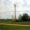 Western Kingbird nest on double cross beam <br /> of this telephone pole <br /> Bridgeton ballpark (BMAC)