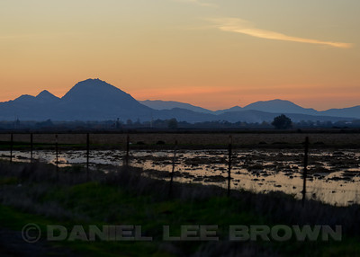 Sutter Buttes at sunset. DFG Swan Tour in Distrist 10, Yuba County, CA, led by Brian Gilmore and Dan Brown, 11-24-12. Cropped image.