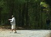 Mike asks for directions after being set down in the woods on a dirt road