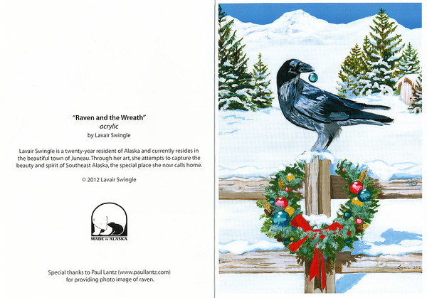 """Greeting card: """"Raven and the Wreath"""" by Lavair Swingle. Raven sitting on fence post decorated with wreath, Raven holding blue ball in beak. Lavair Swingle is a twenty-year resident of Alaska and currently resides in Juneau. Through her art, she attempts to capture the beauty and spirit of Southeast Alaska, the special place she now calls home. © Lavair Swingle. Photo image of raven by Paul Lantz. 2012 December 25"""
