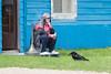 Raven on lawn with Denise Lantz.