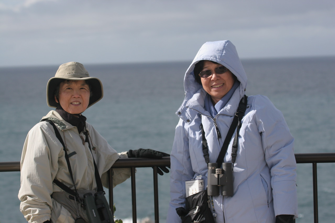 Our guide Eunice on the right. She was feeling a little bit under the weather but still took us out in the wind, cold and rain. She took us to Laguna Beach, where we visited Crystal Cove Beach and Crescent Bay Point Park. After she treated us to a wonderful lunch in Seal Beach,  we drove to Bolsa Chica where she knew of a Reddish Egret that could be photographed. And .... YES WE DID!!! Thanks Eunice