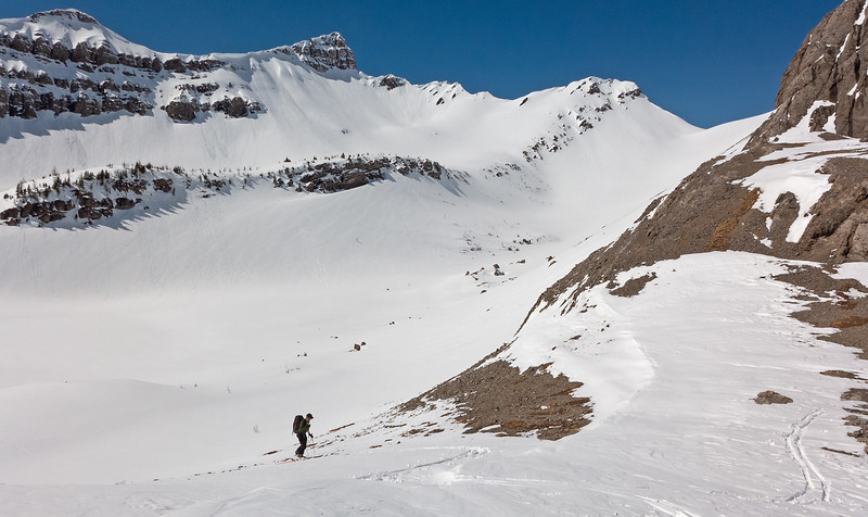 Working the patches of snow to the col.