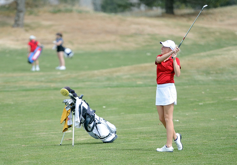 Katelyn Lehigh hits an iron onto the green during the Birleffi Invite at Boomerang Golf Course on Friday, April 5. Loveland won the team title. (Colin Barnard/Loveland Reporter-Herald)