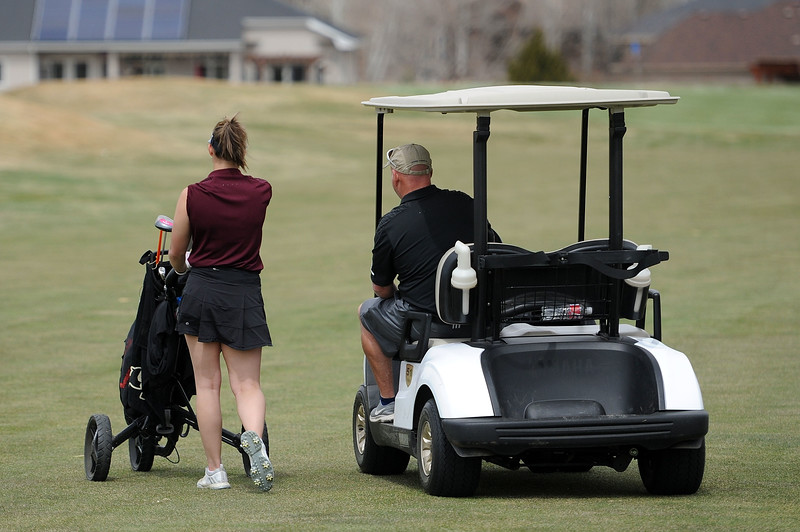 Tatum Graham walks with coach Dave Hunn during the Birleffi Invite at Boomerang Golf Course on Friday, April 5. Loveland won the team title. (Colin Barnard/Loveland Reporter-Herald)