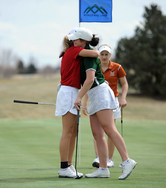 Lauren Lehigh and Fossil Ridge's Leigha Devine hug after their round at the Birleffi Invite at Boomerang Golf Course on Friday, April 5. Loveland won the team title. (Colin Barnard/Loveland Reporter-Herald)