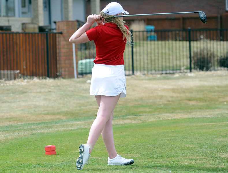 Taylor Bandemer holds her follow through after a tee shot during the Birleffi Invite at Boomerang Golf Course on Friday, April 5. Loveland won the team title. (Colin Barnard/Loveland Reporter-Herald)