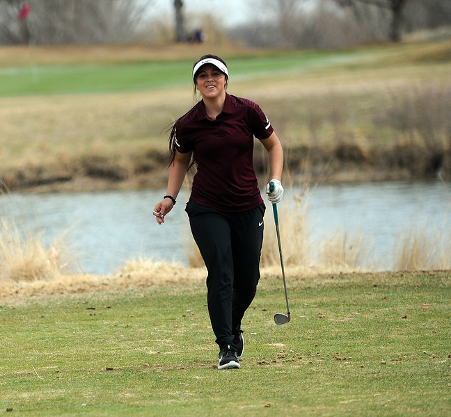Berthoud's Cora Fate smiles after her tee shot on the par-3 4th hole at Boomerang Golf Course during the Birleffi Invite. (Colin Barnard/Loveland Reporter-Herald)