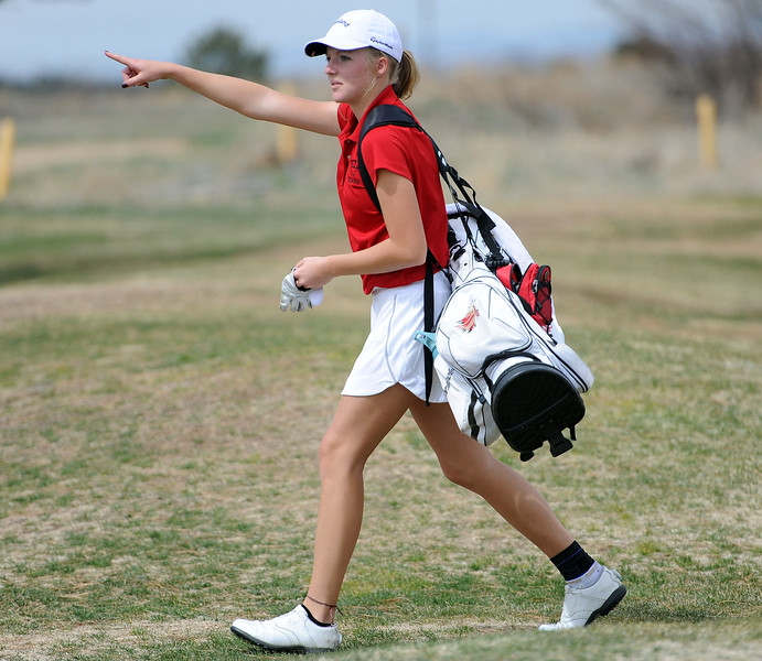 Lauren Lehigh walks to the 15th tee box during the Birleffi Invite at Boomerang Golf Course on Friday, April 5. Loveland won the team title. (Colin Barnard/Loveland Reporter-Herald)