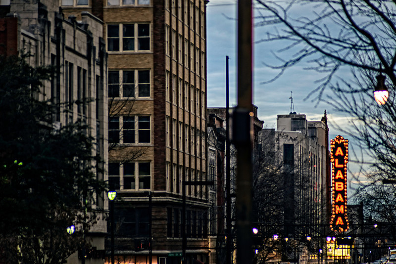 Street view of the Alabama Theatre at sunset.