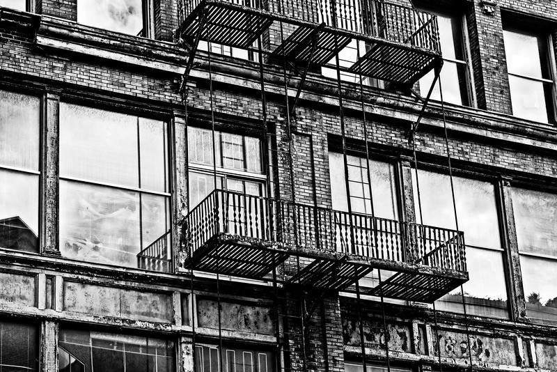 old building, rusty fire escape, late afternoon