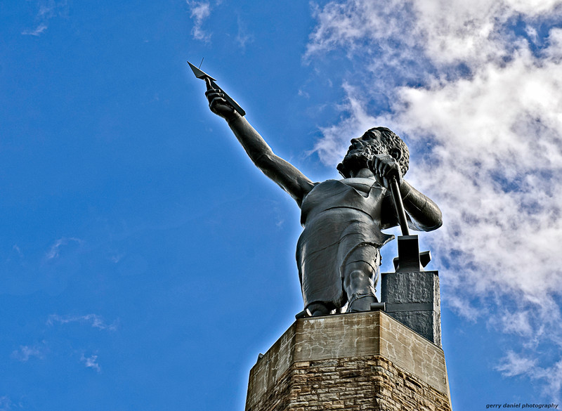 the statue of Vulcan overlooking the city of Birmingham, AL