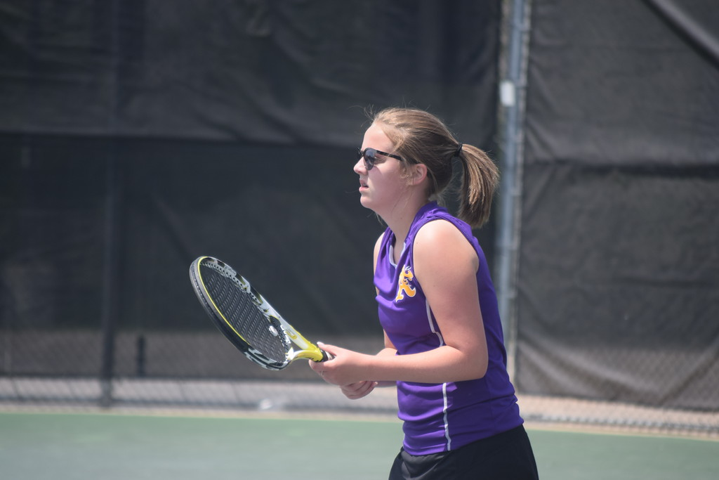 . Birmingham Seaholm (wearing coral) captured a Division 2 MHSAA regional tennis title over Bloomfield Hills Marian on Friday. (Photo by Paula Pasche)