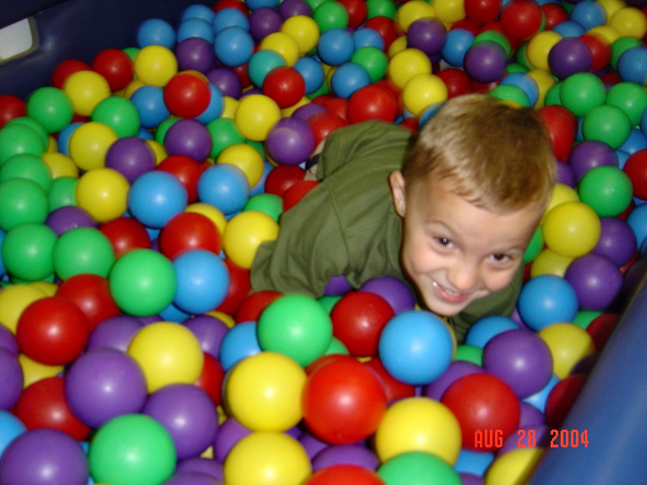 Ty_plays_in_the_balls_at_Natalie's_party_08-28-04
