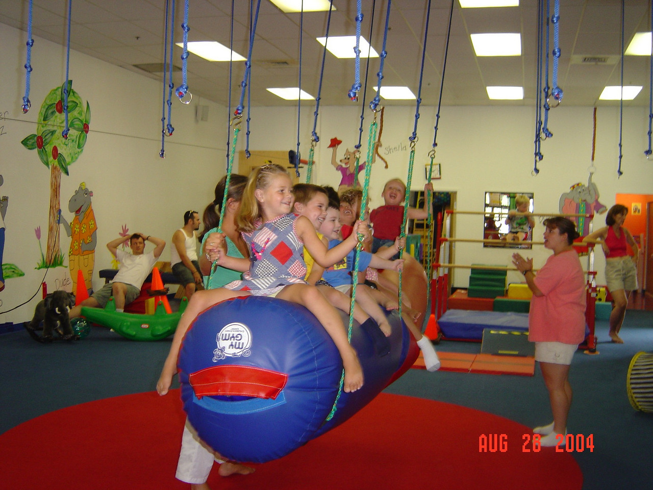 The_kids_swing_at_Natalie's_party_08-24-04