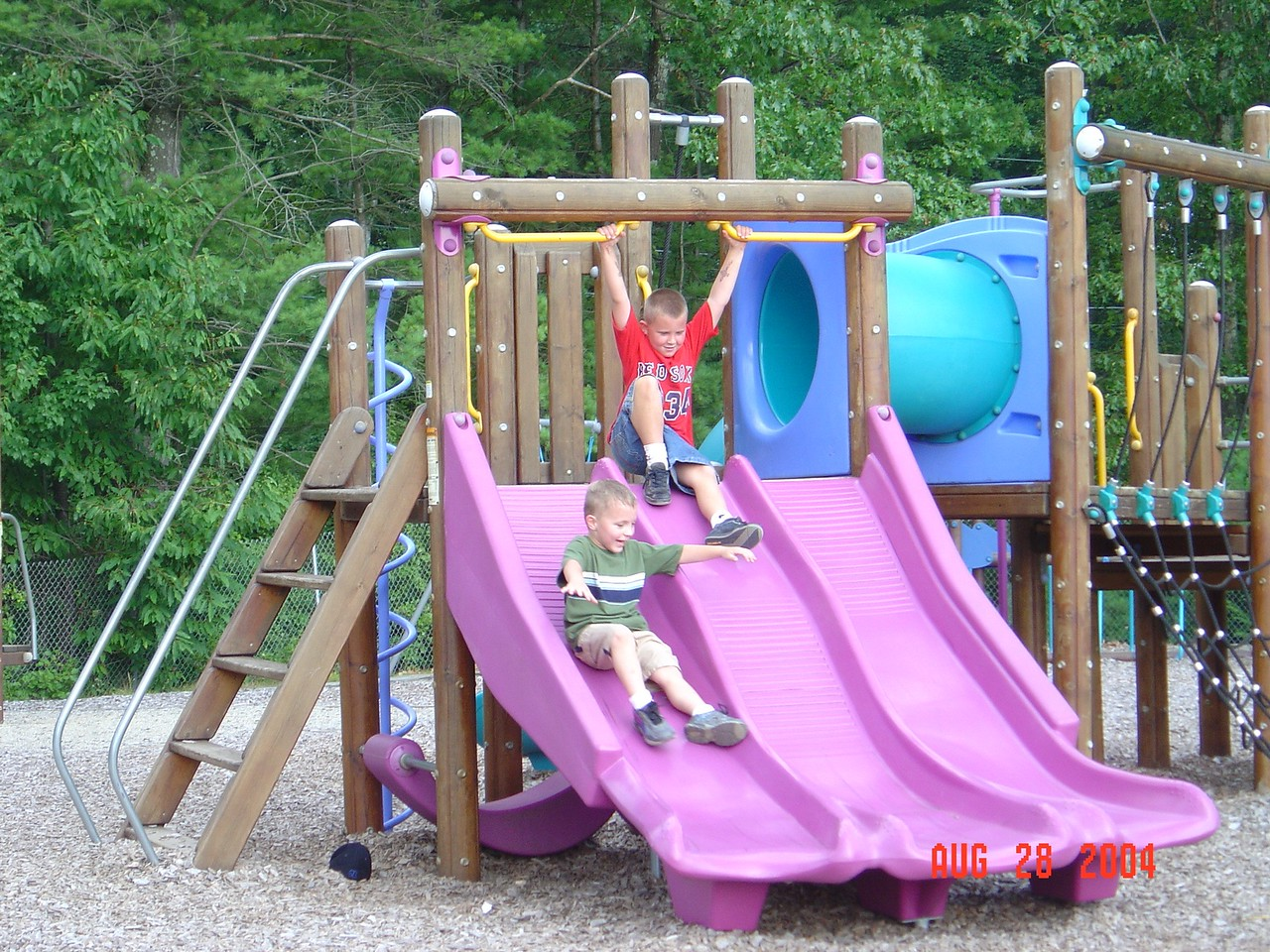 Tyler_and_Dylan_slide_at_Dylan's_party_08-28-04