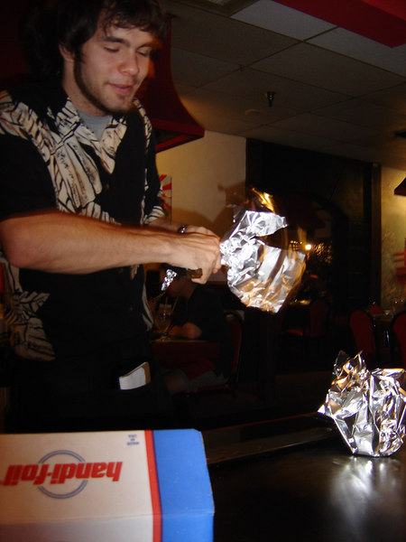 "Our waiter prepares our ""doggy bags""."