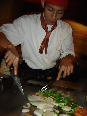 Slicing and dicing our grilled vegetables.