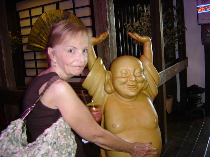 Joan rubbing Budda's belly for good luck.