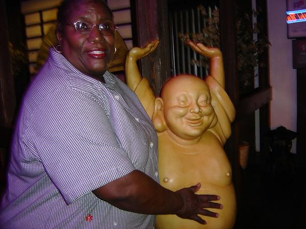 Clem rubbing Budda's belly