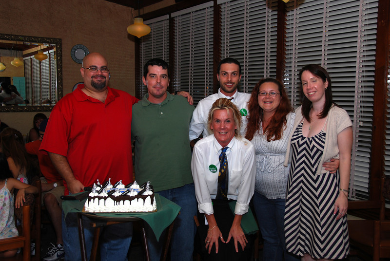 Birthday boys with their wives and waiters.
