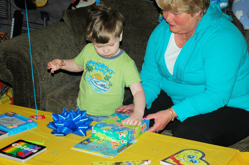 Chandler and Grandma opening his new books