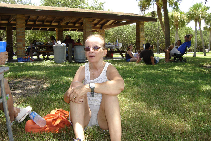 Joan sits in the shade.