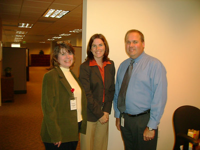 Executive Comp team ready for cake - Cindy, Jill, and Mike.