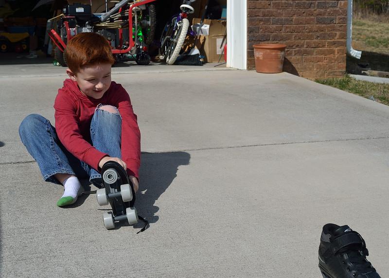 Aidan with his skates.