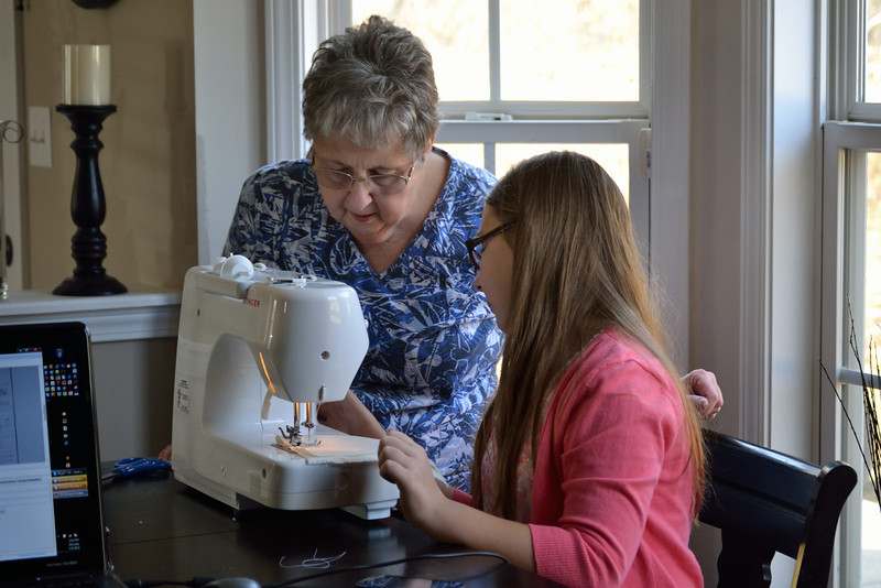 Grandma giving Grace her first lesson in sewing.  Sewing machine was Grace's Christmas gift from her mother.