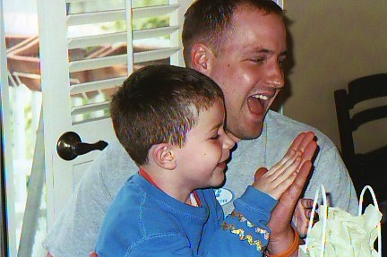 Lucas & Timm celebrating Max opening his gag gift (string cheese) 2005
