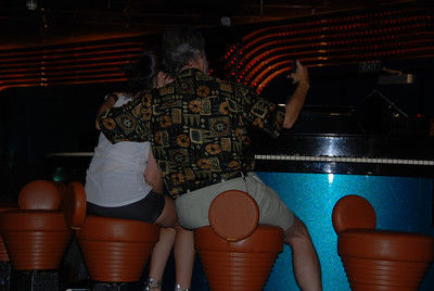 Summer and Larry check out the priveledges of the piano bar....