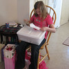 Nanny gives her a bucket of scrapbooking supplies.