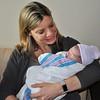 Grandma Karina cradling Baby Jer