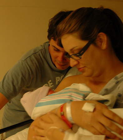 A tender moment....<br /> Daddy Zac & Maman Summie, with Eliana Faith in the Recovery Room..