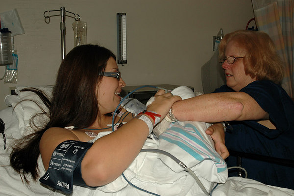 Summer holds Ella for the First time in the Recovery Room, out of the OR Theater,