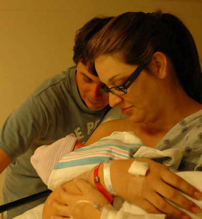 A tender moment....<br /> Daddy Zac & Maman Summie, with Eliana Faith in the Recovery Room.