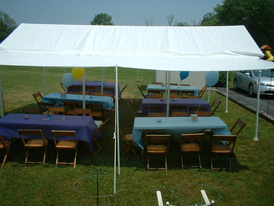 Chris' mom rented the tables and chairs and a friend from Chelsea's congregation put up the tent for the party.