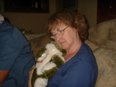 Mom cuddling with a frog!