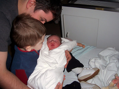 Big brother Evan meets tiny little brother Eli for the very first time!  :) - Rm at RVH - evening of Nov 30, 2010