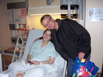 Happy Grandad gives Emily a hug  :)